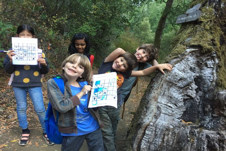 Children on Trail Smiling with Activity Sheets