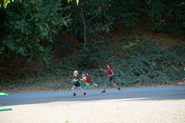 Kids Running on Farm Road
