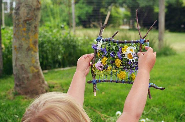 Child Holding up Nature Craft