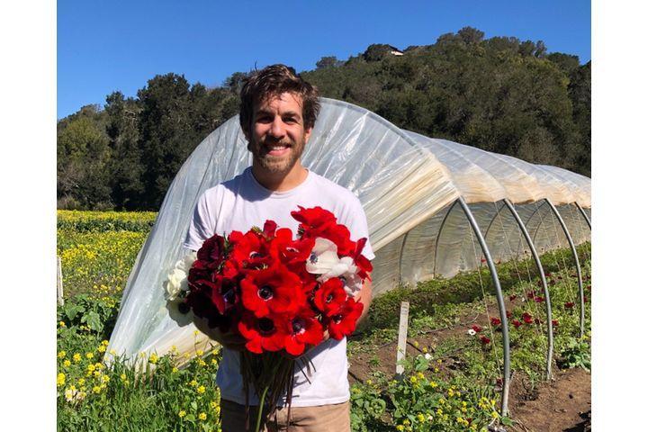 Farmer Holding Flowers